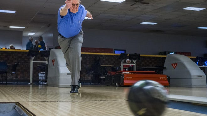 Roy Fort, 90, sends a ball down the bowling lane at Landmark Lanes last year. Bowling centers are slated to reopen Friday in Illinois.