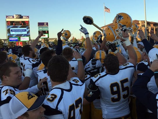 Viking players celebrate taking back the Key to the