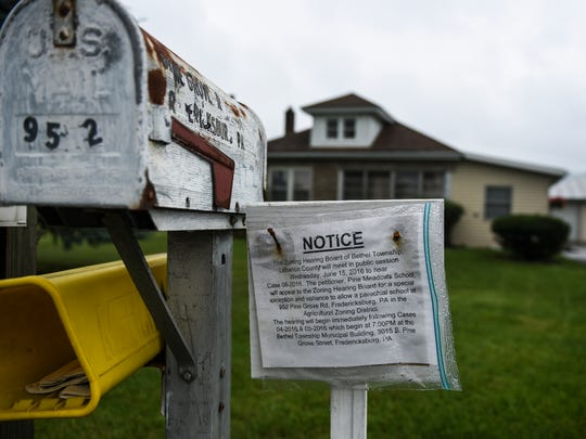 A notice is posted at 952 Pine Grove Road in Bethel Township, the site where Pine Meadows School wants to build a new school. The Bethel Township Zoning Hearing Board granted a special exception and variance for the project on Wednesday, June 15, 2016.