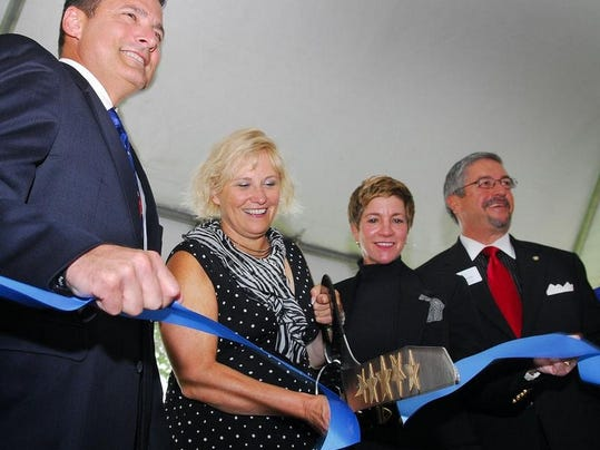 File photo shows the 2012 ribbon-cutting ceremony at BlueWare's facility in Melbourne. CEO Rose Harr, second from left, says, 'Right