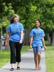 Keri Anderson walks with her little sister, Shyanne,