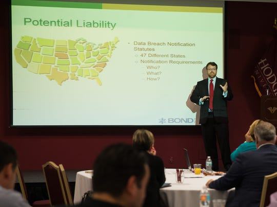 Thomas Rinaldi, a trial attorney at Bond Schoeneck & King, PLLC, addresses the audience during the Data Privacy and Cyber Liability conference as a part of the Identity Fraud Institute at Hodges University on Wednesday, Sept. 21, 2016. The mission of the Identity Fraud Institute is to learn, share and collaborate through educational opportunities for the community and professionals in Lee and Collier counties.