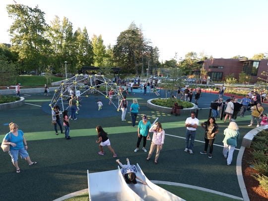 Families attend the grand opening of the Let's All Play Place on Thursday, Sept. 15, 2016, in Salem. The therapy and community play area is located at the corner of Mission Street SE and Church Street SE on the Salem Health campus.