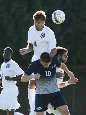 St. Michael's Gonzalo Mengotti (4) leaps over St. Anselm's Jack Lynch (10) to head the ball during the men's soccer game at Duffy Field on Wednesday in Colchester.