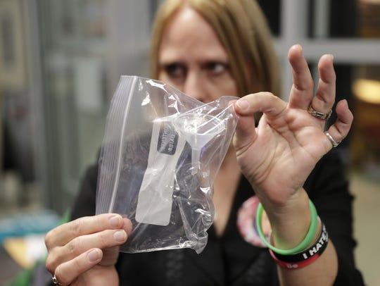 Bev Kelley-Miller holds up a funnel that was hidden