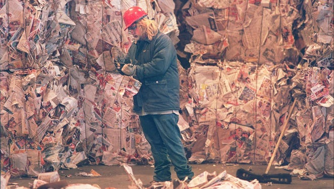 A file photo of an employee at the county's recyling center.