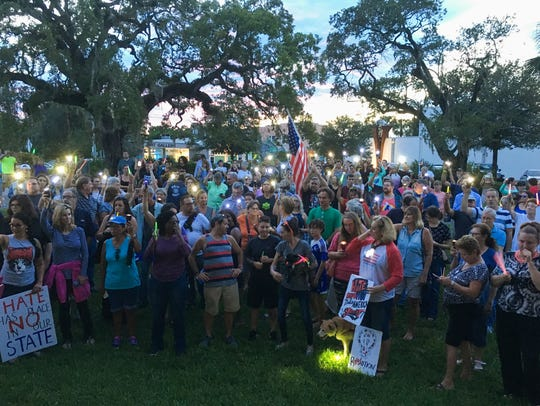 About 250 gathered at Eau Gallie Arts District on Sunday
