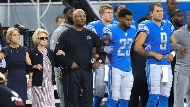 The Detroit Lions took a knee and joined arms in protest of statements made by president Trump before action against the Atlanta Falcons Sunday, September 24, 2017 at Ford Field  in Detroit, MI.