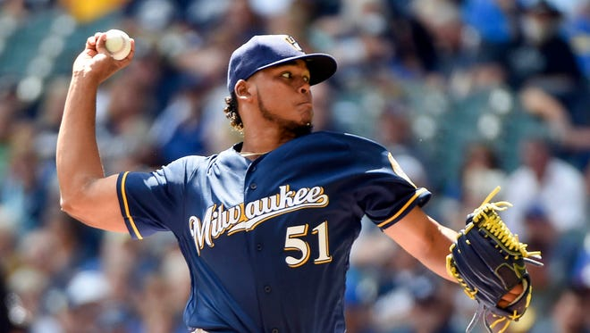 Brewers pitcher Freddy Peralta throws a pitch against the Cincinnati Reds at Miller Park last season.