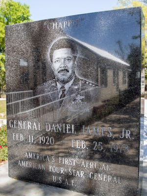 "The house itself is reflected in the granite memorial is on display outside the ""Chappie"" James house in Pensacola on Wednesday, April 4, 2018.  Daniel ""Chappie"" James, Jr. was America's first African-American four-star general (USAF)."