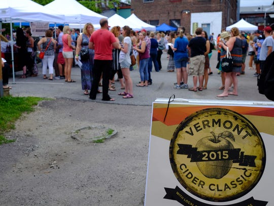 People mingle as they wait their turn to tase samples at  the 2015 Vermont Cider Classic on July 25, 2015,  at ArtsRiot in Burlington.