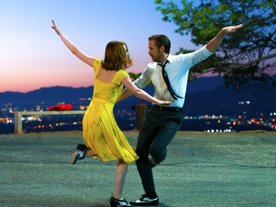 "Emma Stone and Ryan Gosling in ""La La Land,"" playing at the Fine Arts Theatre in downtown Asheville and at the Regal Biltmore Grande."