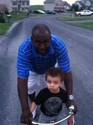 Brandon Cole and his son. Cole was killed in a triple