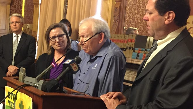Bob Lewis, 63, of Des Moines, who has severe pain from multiple medical conditions, issues a plea to state lawmakers Tuesday to pass a comprehensive medical marijuana law. At his right is Rep. Bob Kressig, D-Cedar Falls. From far left is Rep. John Forbes, D-Urbandale, and Sally Gaer of West Des Moines.