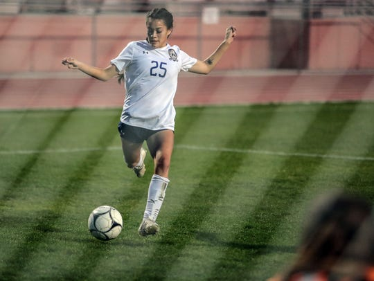 Blackhawk Tatiana Woodworth tries to score against