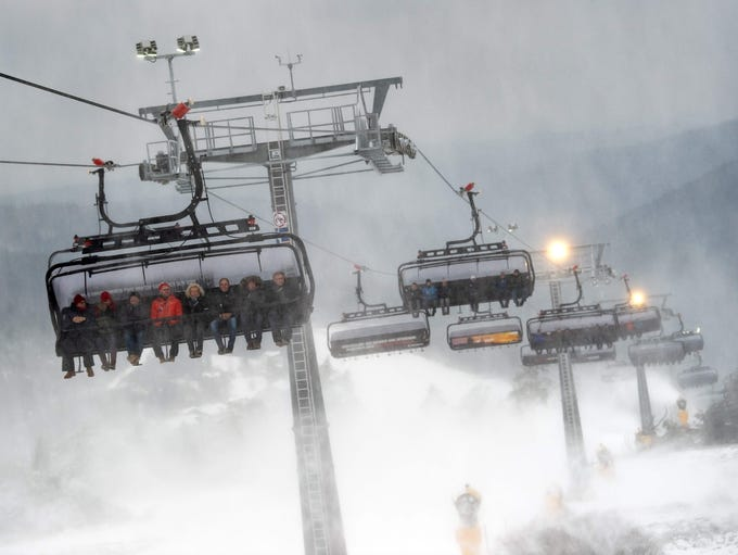 """Guests sit in cars of the new """"K1"""" chairlift during"""