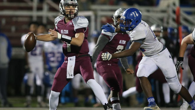 Alcoa quarterback Walker Russell (1) looks to pass the ball as Red Bank's Ivan Young Jr. approaches to tackle Russell during a TSSAA football semifinal play-off game on Friday, Nov. 24, 2017. (Crystal LoGiudice/Special to the News Sentinel)
