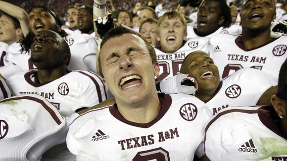 Johnny Manziel celebrated Texas A&M's upset win over eventual 2012 national champion Alabama at Bryant-Denny Stadium in Tuscaloosa.