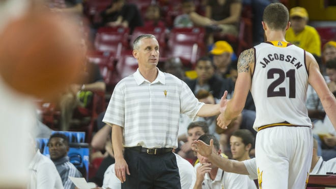 ASU's head coach Bobby Hurley high fives Eric Jacobsen as he leave the court during an exhibition game at Wells Fargo Arena in Tempe, AZ on Nov. 7, 2015.
