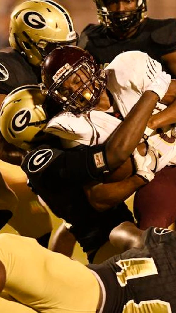 Greer's defense smothers Woodruff's Demi Dale (20).