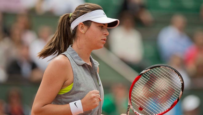 Ajla Tomljanovic celebrates a point during upset victory over third-seeded Agnieszka Radwanska.