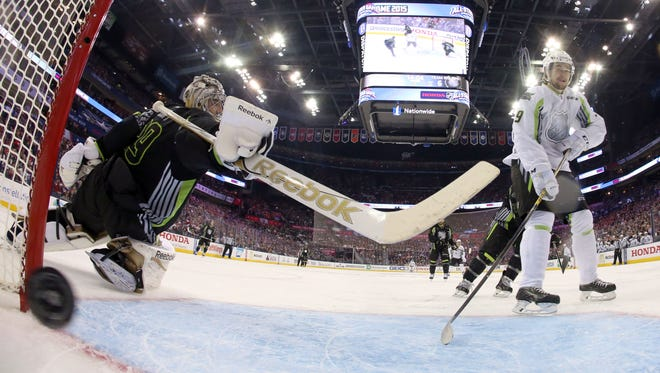 Team Foligno goalie Marc-Andre Fleury of the Penguins can't stop a shot by Team Toews' Filip Forsberg of the Predators during the second period Sunday.