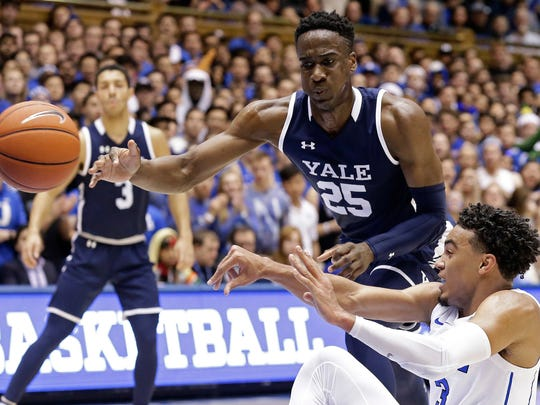 Duke's Tre Jones passes while Yale's Miye Oni (25) defends during the first half of an NCAA college basketball game in Durham, N.C., Saturday, Dec. 8, 2018. (AP Photo/Gerry Broome)