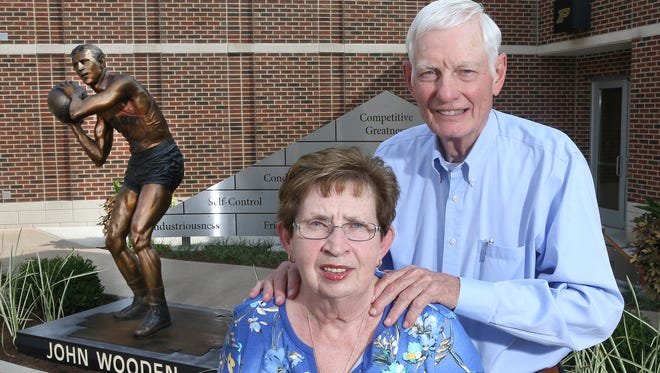 Jim and Neta Hicks stand in front of the statue of former Purdue player John Wooden they donated. Purdue will hold a dedication ceremony for the statue on Saturday morning.