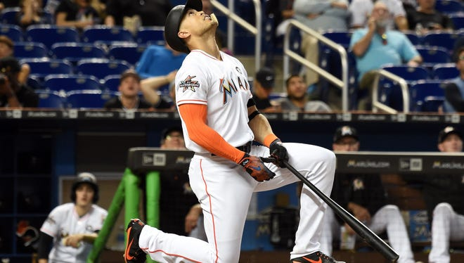 """I can't control what's going to happen,'' slugger Giancarlo Stanton says of the impending Marlins sale. He often plays before sparse crowds in Miami."