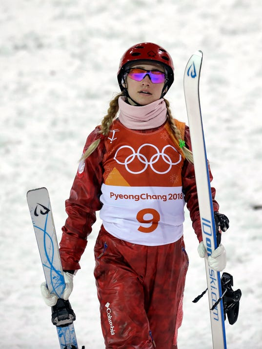 Russian athlete Alexandra Orlova carries her skis after crashing during the women's freestyle aerial final at Phoenix Snow Park at the 2018 Winter Olympics in Pyeongchang, South Korea, Friday, Feb. 16, 2018. (AP Photo/Kin Cheung)