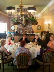 A group of women dine at The Veranda in downtown Fort
