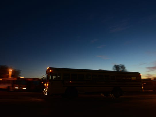 A bus leaves for its morning route from the Lamers
