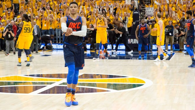 Oklahoma City Thunder guard Russell Westbrook walks off the court after losing Game 6 of their first-round series to the Jazz.
