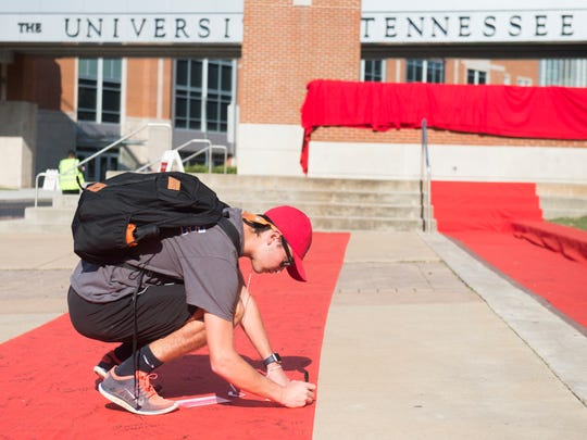 University of Tennessee freshman Will Olive signs the Red Zone pledging to speak up against sexual assault during a Red Zone event held outside of the Alumni Memorial Building on UT's campus on Monday, Sept. 18, 2017.