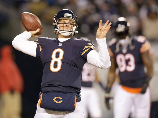 Chicago Bears quarterback Jimmy Clausen (8) warms up before an NFL football game against the Dallas Cowboys, Thursday, Dec. 4, 2014, in Chicago.