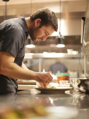 Selden Standard's executive chef and partner Andy Hollyday works in the kitchen of his recently opened restaurant in Detroit on Monday, November 24, 2014.