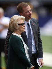 Lions owner Martha Firestone Ford and GM Bob Quinn on the field before action against the Indianapolis Colts on Sept. 11, 2016 at Lucas Oil Stadium.