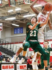 Kip French makes an acrobatic layup for Howell in a