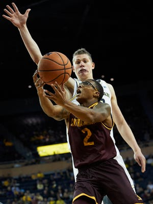 Central Michigan guard Shawn Roundtree (2) goes to the basket defended by Michigan forward Moritz Wagner (13) in the second half of U-M's 72-65 win on Monday, Nov. 13, 2017, at Crisler Center.