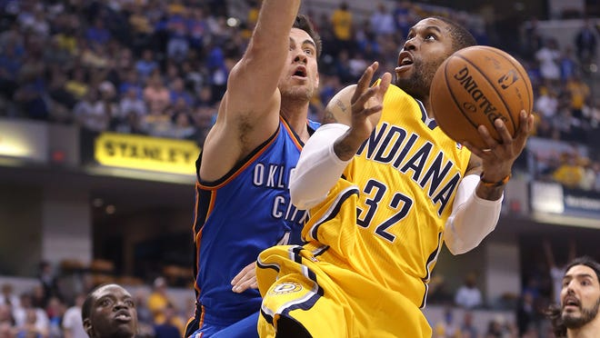 Pacers C.J. Watson shoots and is fouled by Thunder's Nick Collison in the first half of their game Sunday, April 13, 2014, afternoon at Bankers Life Fieldhouse.