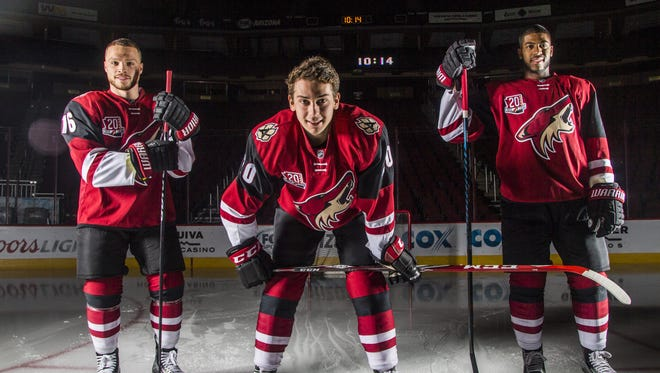 Coyotes young trio Dylan Strome (center), Max Domi (L) and Anthony Duclair pose for portraits at Gila River Arena on October 8, 2016 in Glendale, Ariz.