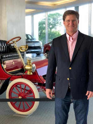 Ted Ryan, Archives and Heritage Brand Manager at Ford Motor Company, at world headquarters  in June  2018 in Dearborn with a 1903 Model A, the oldest surviving Ford car. It was one of the first three ever produced.