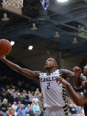 After getting a steal in the backcourt, Georgia Southern's Mike Hughes, left, scores and draws a foul on Louisiana's Jerekius Davis late in the second half at Hanner Fieldhouse Monday. Hughes, who led all scorers with 20 points, sank the free throw to give the Eagles a four point lead with just over a minute left to play.
