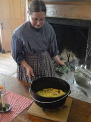 """Enjoy a delicious hearth-cooked meal, prepared with your own hands, in the historic Wade House stagecoach hotel during Wade House's """"Breakfast at the Inn""""."""