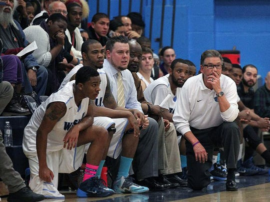 Jerry Kobasa (right) coaches the men's basketball team at Wesley College. He played football there and at Delaware State University.