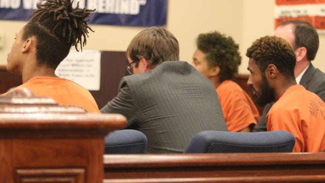 Javian Hawkins, left, Reginald Pope and Kymber Green, all in orange, sit with attorneys at a preliminary hearing in General Sessions Court on Monday.