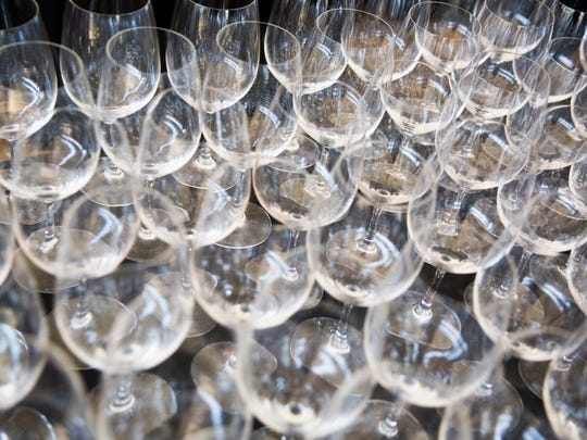 "Dozens of wine glasses sit out during the 2017 ""Bright Sunshiny Day"" Auction at the Naples Winter Wine Festival on Saturday, January 28,  2017 at the The Ritz-Carlton Golf Resort in North Naples."