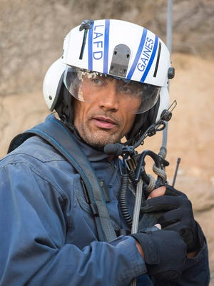 Dwayne Johnson stars as a helicopter rescue pilot in 'San Andreas,' in theaters Friday May 29.