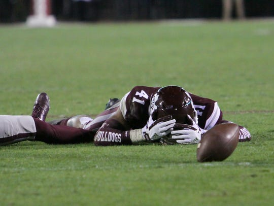 Mississippi State's Mark McLaurin (41) and Mississippi