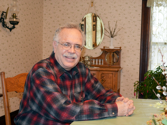 Tony Fuller, Sandra Fuller's husband for 30 years, sits in the dining room of the historic New London farmhouse.